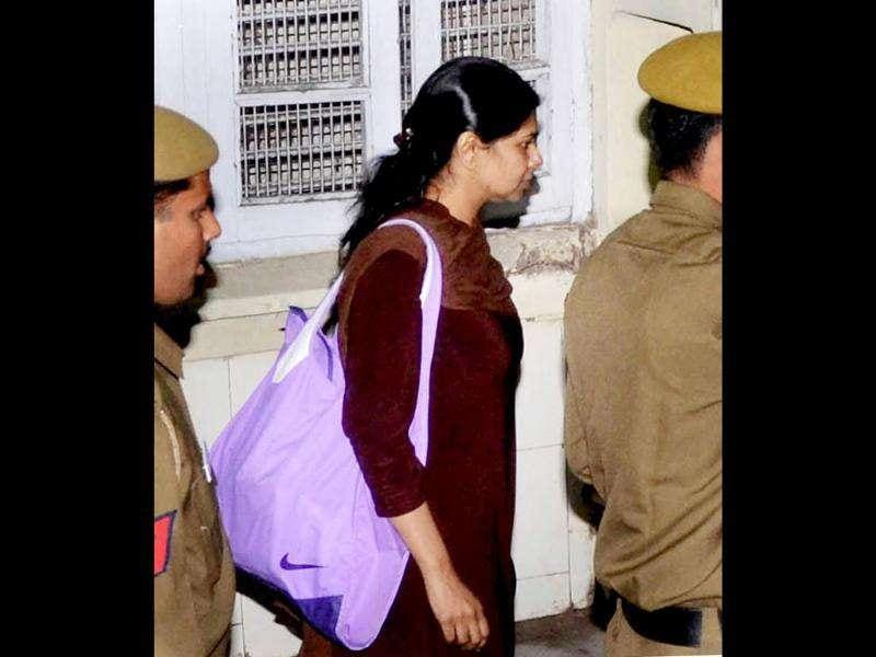 DMK MP Kanimozhi is escorted at Patiala House court in New Delhi on Monday. Kanimozhi and four others were granted bail by the Delhi High Court in the 2G spectrum allocation scam case. PTI Photo