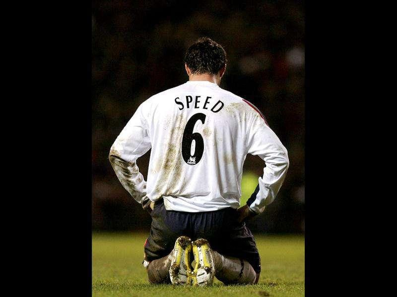 (Files) Bolton Wanderers' Gary Speed is seen reacting after a Manchester United goal during the English Premier League soccer match at Old Trafford in Manchester in this December 31, 2005. Gary Speed, the manager of the Wales national team, was found dead on Sunday at the age of 42, the Football Association of Wales (FAW) said in a statement on Sunday. Reuters/Philip Brown