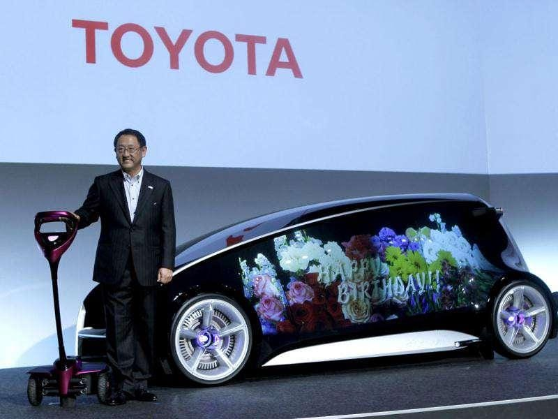 President and CEO of Toyota Motor Corporation Akio Toyoda poses with self-balancing two-wheeled scooter Winglet and concept vehicle Fun-Vii at a pre-Tokyo Motor show reception at its showroom in Tokyo. The whole body of the concept car can be used as a display space, with the body color and display content changeable at will, and allows the vehicle to function as a terminal for displaying messages or other information, the company said. Reuters/Kim Kyung-Hoon