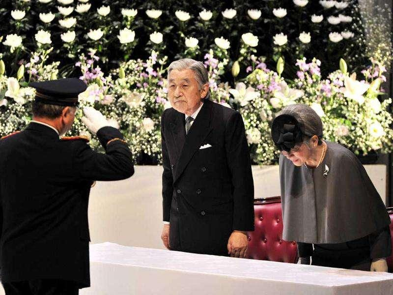 Japanese emperor Akihito (C), accompanied by empress Michiko (R), attends a memorial service in Tokyo for firefighters who died on duty following the March 11 earthquake and tsunami. AFP Photo/Yoshikazu Tsuno