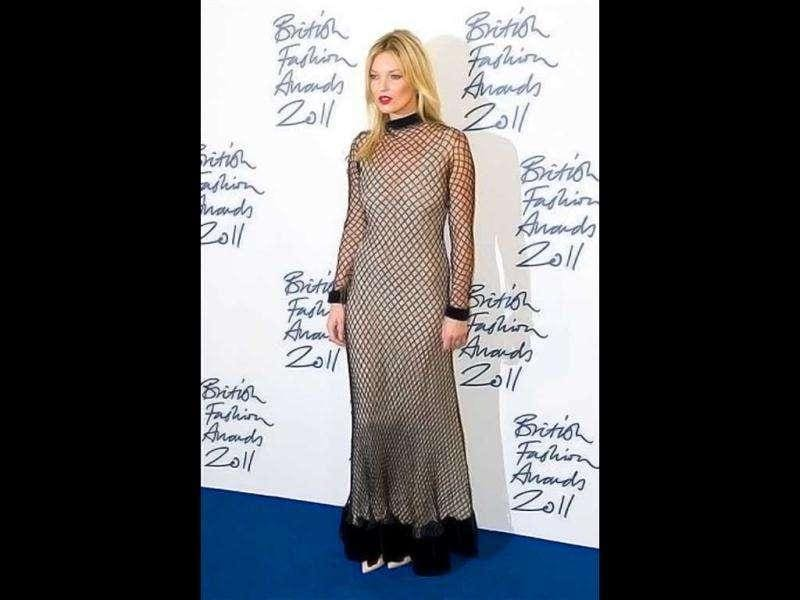 Kate Moss seems to have made a dress from her fishnet stockings. (AP)