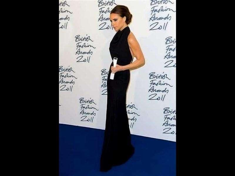Victoria Beckham in a black backless gown definitely doesn't look like she recently gave birth. (AP)