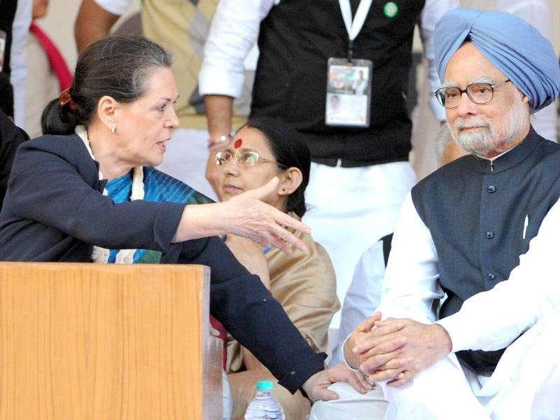 Sonia Gandhi speaks to Prime Minister Manmohan Singh at the Youth Congress National convention in New Delhi.