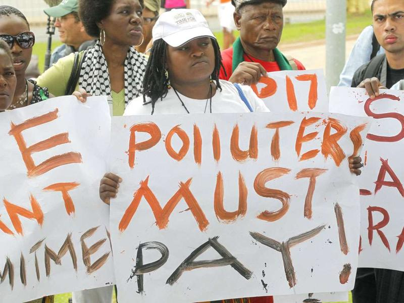 Environmental activists demonstrate outside the United Nations Framework Convention on Climate Change Conference of the Parties meeting (COP17) in Durban.