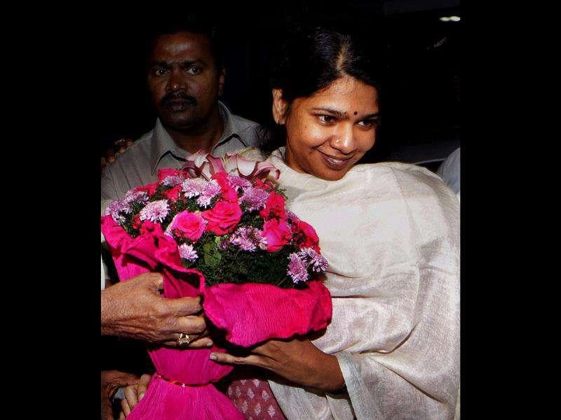 DMK MP Kanimozhi receives a bouquet after her release from Tihar Jail in New Delhi.
