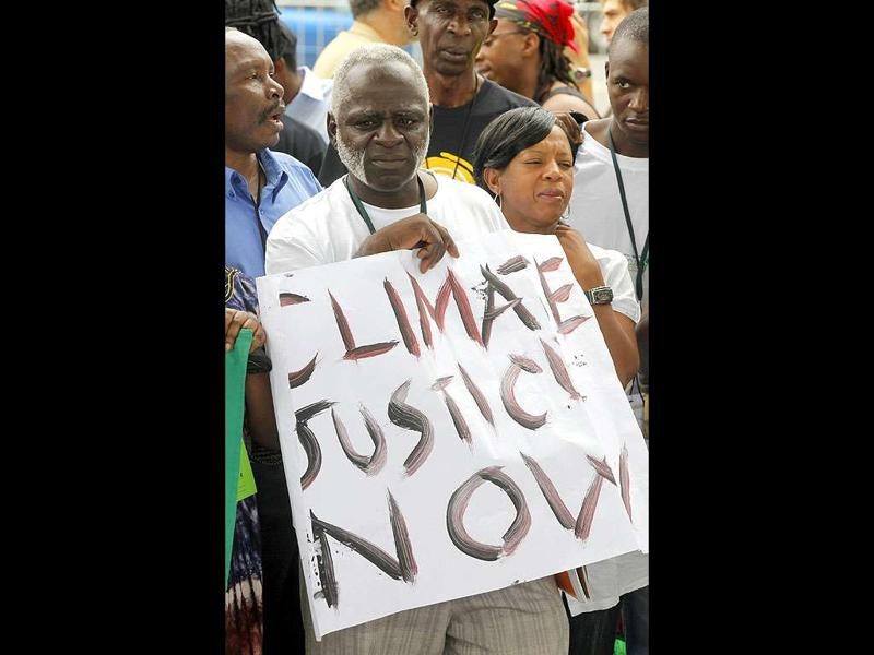Environmental activists demonstrate outside the United Nations Framework Convention on Climate Change Conference of the Parties meeting (COP17) in Durban. The gathering runs until December 9.