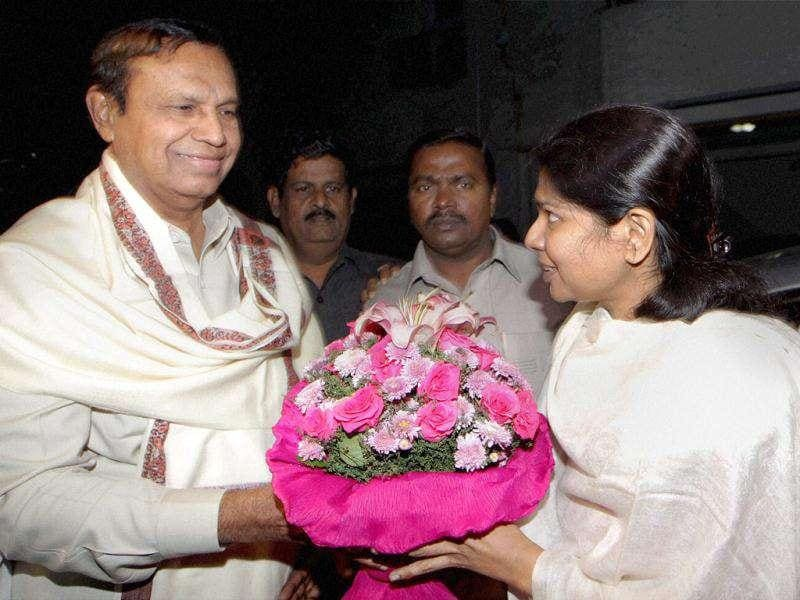 DMK MP Kanimozhi receives a bouquet from DMK leader TR Baalu at her residence after her release from Tihar Jail in New Delhi.