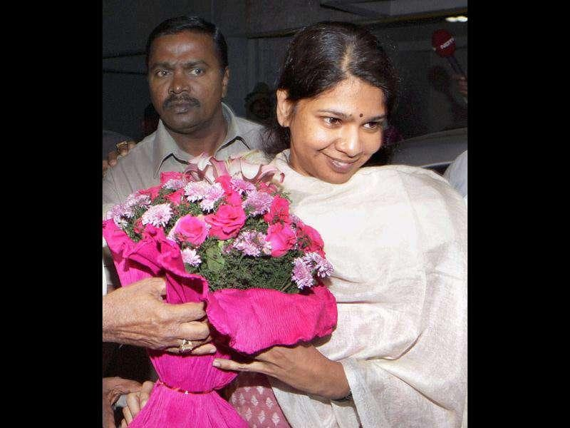 DMK MP Kanimozhi recieves a bouquet at her residence after her release from Tihar Jail in New Delhi.