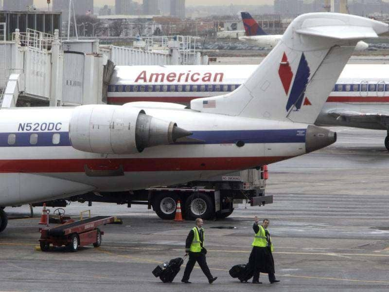 American Airlines' planes are parked at a gate at LaGuardia Airport in New York. AP