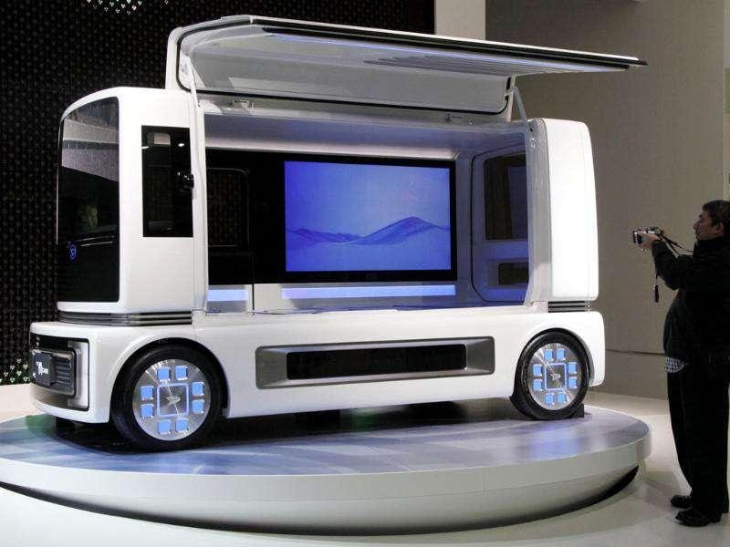 A visitor snaps Daihatsu Motor Co., concept car