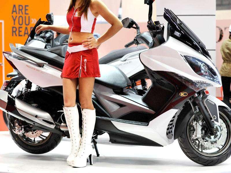 A model displays the new motorcycle 'Scooter xciting 400i' of Taiwanese maker Kymco during the Tokyo Motor Show in Tokyo.