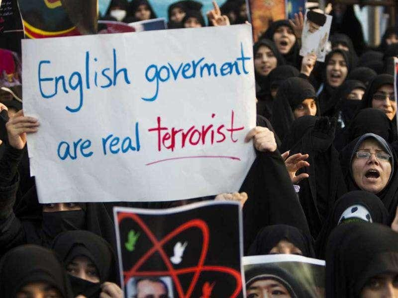 Iranian protesters shout slogans during a demonstration in front of the British Embassy in Tehran.