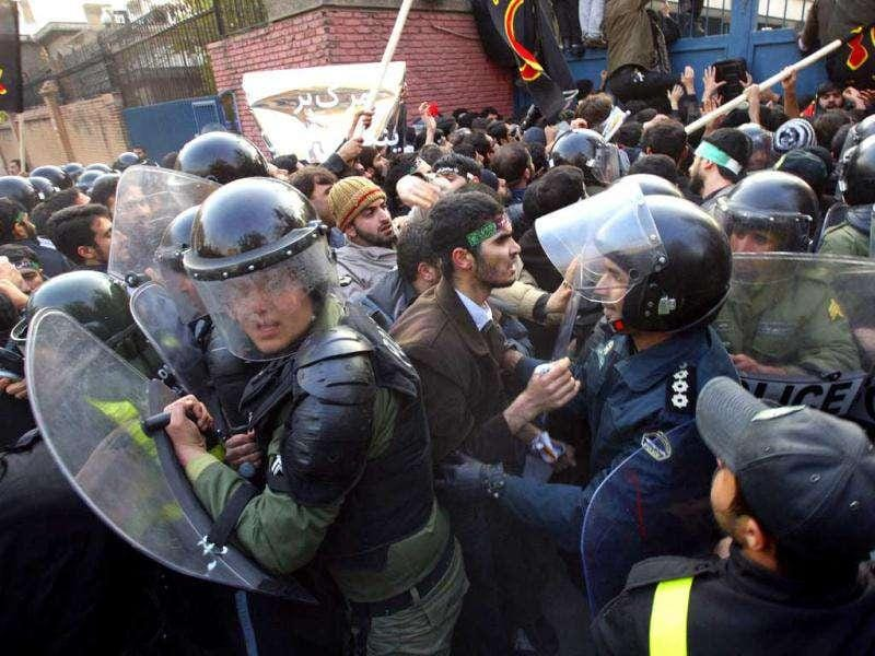 Iranian protesters in a scuffle with police officers as they try to enter the British Embassy in Tehran.