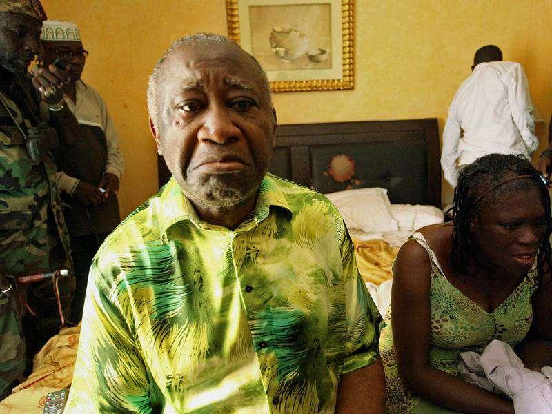 Ivory Coast's Laurent Gbagbo and his wife Simone sit in a room at Hotel Golf in Abidjan, after they were arrested, in this April 11, 2011 file photo. The International Criminal Court confirmed former Ivory Coast President Laurent Gbagbo had been detained in The Hague on November 30, 2011, following his arrest on charges of crimes against humanity and transfer from Ivory Coast overnight. (Reuters)