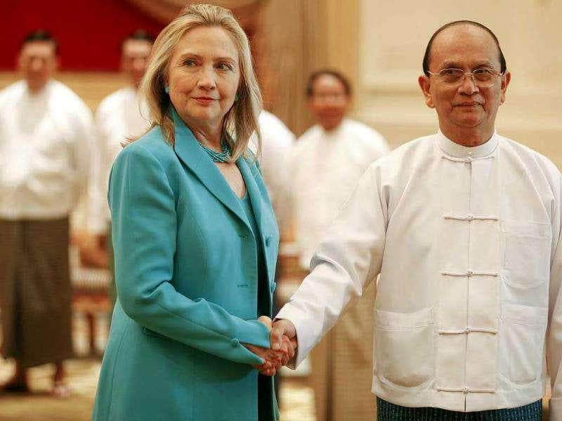 US secretary of state Hillary Clinton (L) shakes hands with Myanmar's President Thein Sein during a meeting at the President's Office in Naypyitaw.