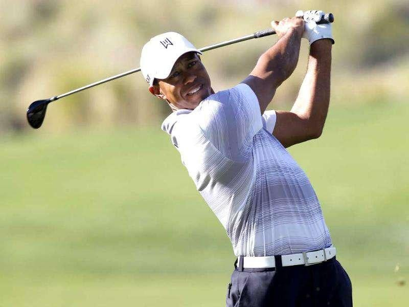 Tiger Woods hits from the 16th fairway during a pro-am round ahead of the Chevron World Challenge golf tournament in Thousand Oaks, California.
