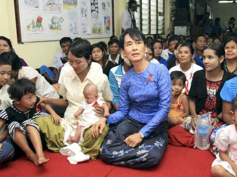 Opposition leader and Nobel peace laureate Aung San Suu Kyi, center, attends an event to mark World AIDS Day celebration at National League for Democracy (NLD) party's headquarters in Yangon, Myanmar. (AP Photo/Khin Maung Win)