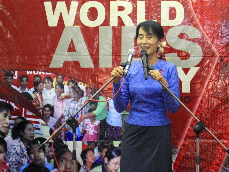 Opposition leader and Nobel peace laureate Aung San Suu Kyi delivers her speech during an event to mark World AIDS Day celebration at National League for Democracy (NLD) party's headquarters, in Yangon, Myanmar. (AP Photo/Khin Maung Win)