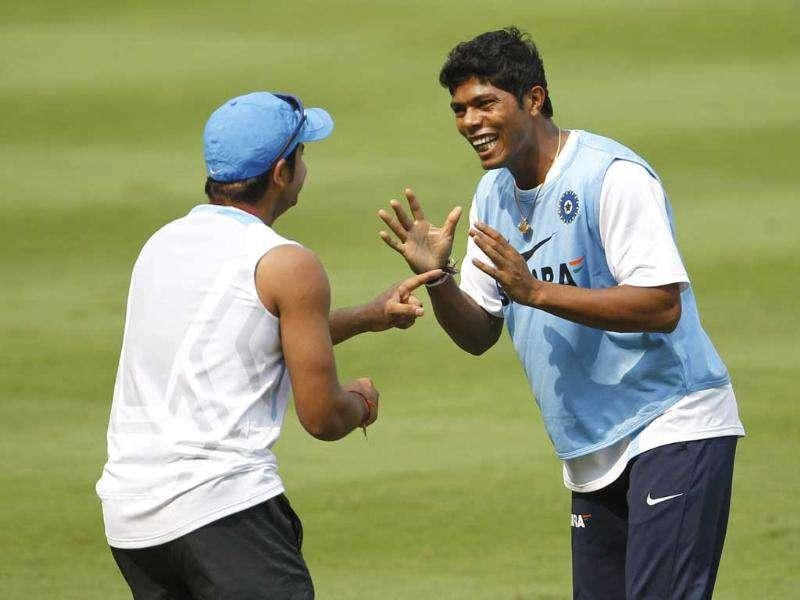 Suresh Raina, left, and Umesh Yadav share a light moment during a training session ahead of their second one-day international cricket match against West Indies in Visakhapatnam.