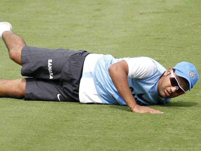 Rohit Sharma stretches during a training session ahead of their second one-day international cricket match against West Indies in Visakhapatnam.