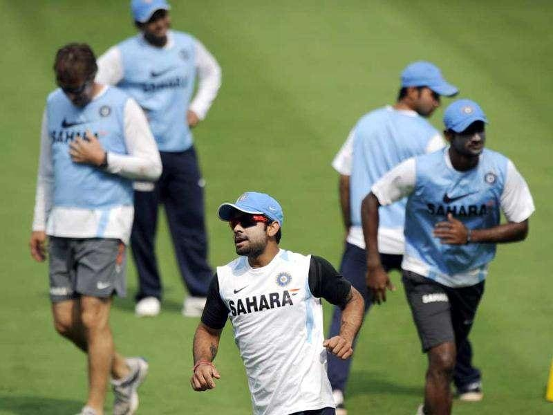 Virat Kohli (C) with teammates plays a game of football during a training session ahead of the second ODI match between India and West Indies at the Dr YS Rajasekhara Reddy Cricket Stadium in Visakhapatnam.