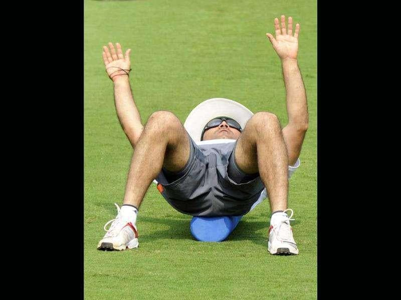 Virender Sehwag stretches during the training session.