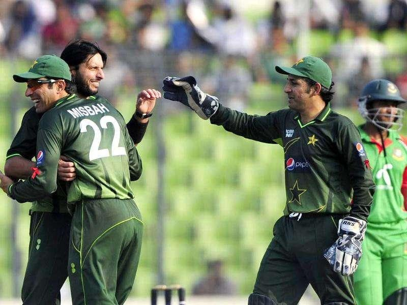Pakistani bowler Shahid Afridi (L) celebrates with teammates after the dismissal of Bangladeshi batsman Shakib Al Hasan (R) during their first ODI match at the Sher-e-Bangla National Cricket Stadium in Dhaka.