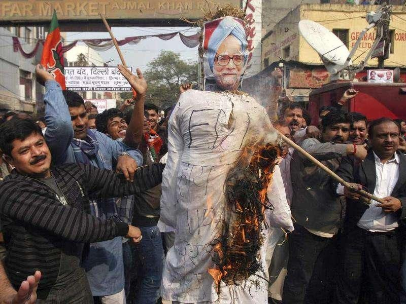 BJP activists burn an effigy depicting Prime Minister Manmohan Singh during a protest against the government's decision to allow foreign direct investment (FDI) in the retail sector, in New Delhi.