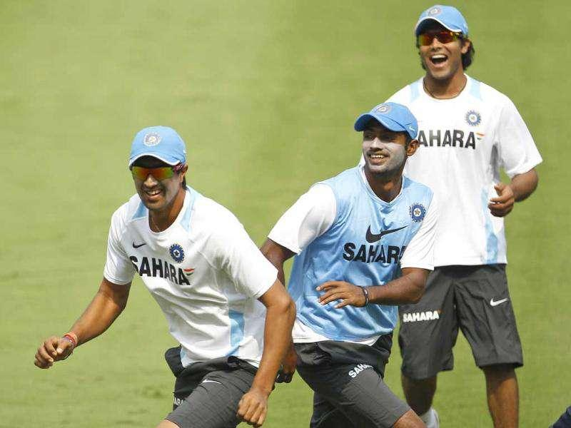 Rahul Sharma, left, Abhimanyu Mithun, center, and Ravindra Jadeja attend a training session in Visakhapatnam.