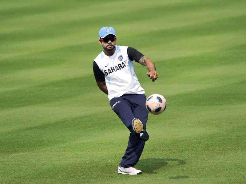 Virat Kohli plays a game of football during a training session at the Dr YS Rajasekhara Reddy Cricket Stadium in Visakhapatnam.
