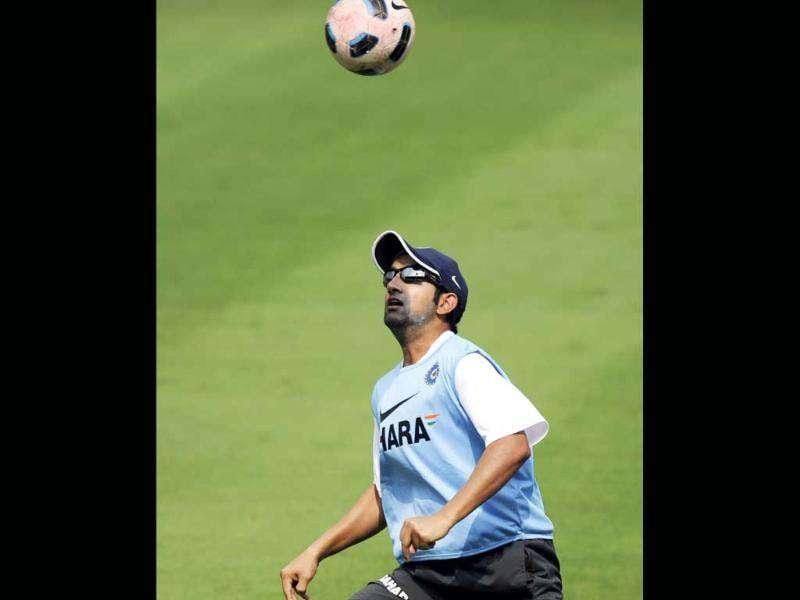 Gautam Gambhir plays a game of football during a training session.