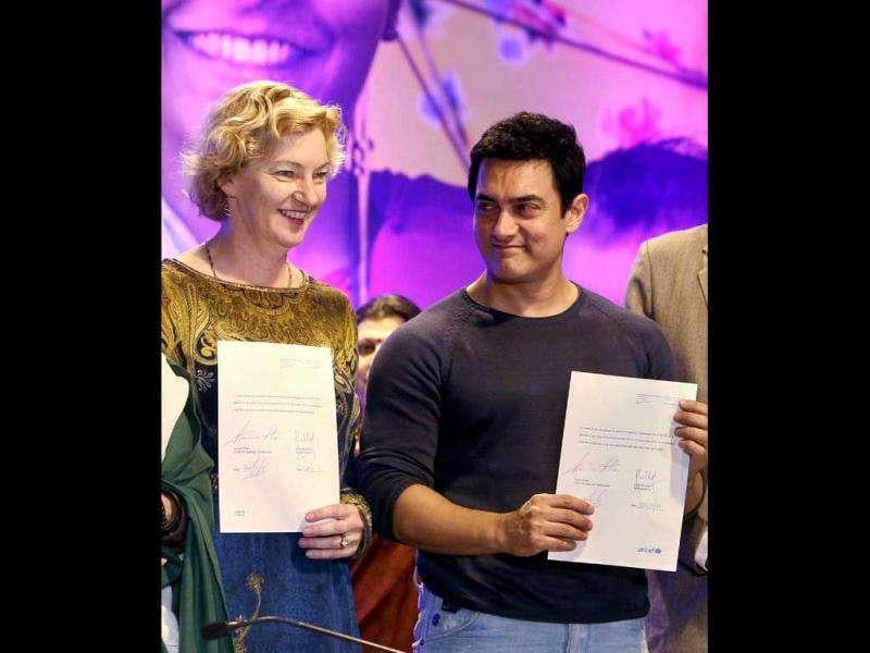 India Country Representative Karin Hulshof and Aamir Khan during the signing ceremony for his appointment. (AP)