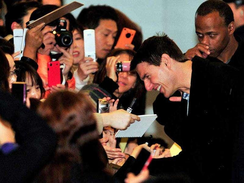 Price of Popularity! Fans went berserk vying for the MI:4 actor's attention. (AFP)
