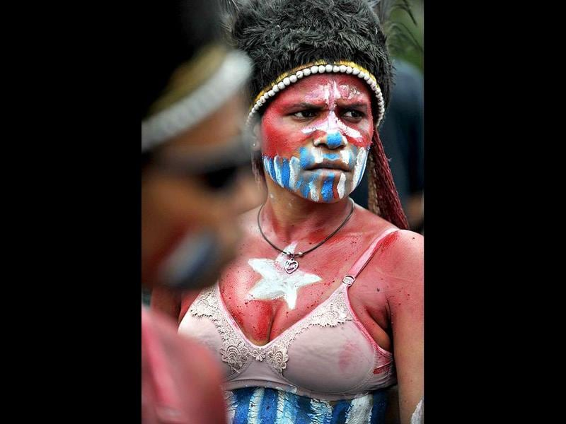 A Papuan protester with her body and face painted displaying the banned Morning Star flag takes part in a rally to mark the 50th anniversary of the region's claim to independence in eastern Indonesia's restive region of Papua, at a demonstration in Jakarta.