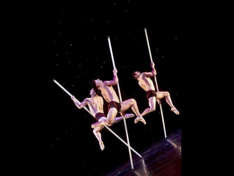 Members of dancer-illusionists company Momix perform during a press rehearsal of its latest show called