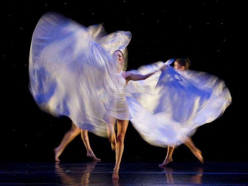 Dancers of the US dance company Momix perform during the rehearsal of the