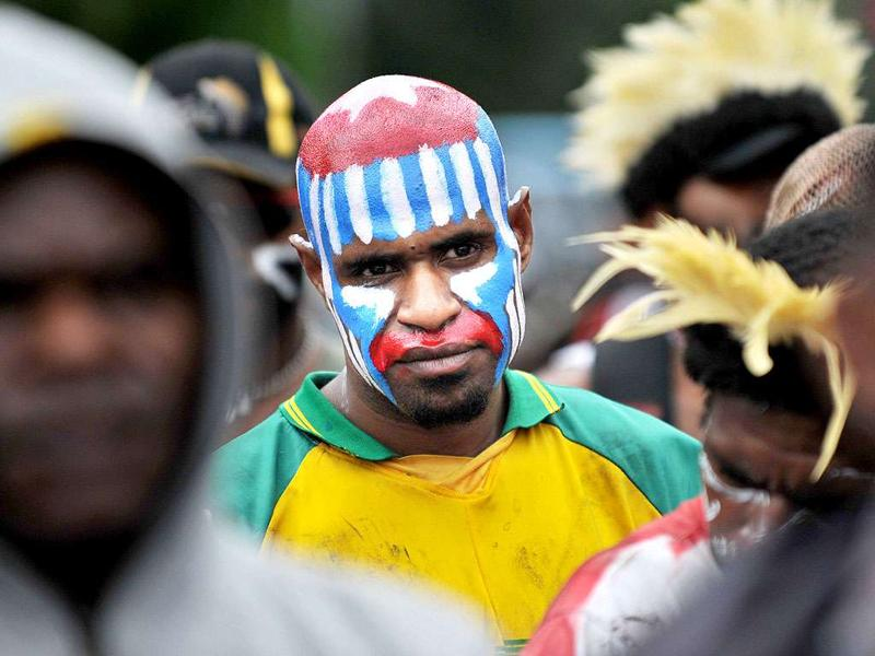 A Papuan protester with his face painted displaying the banned Morning Star flag takes part a rally to mark the 50th anniversary of the region's claim to independence in eastern Indonesia's restive region of Papua, at a demonstration in Jakarta.