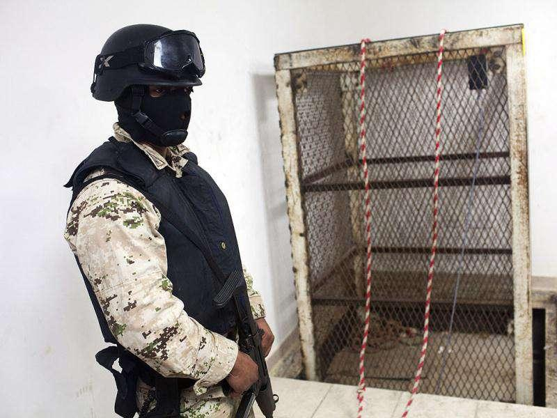A Mexican army soldier stands next to an elevator shaft that lowers into a tunnel in the northern border city of Tijuana, Mexico. US authorities said they discovered a new cross-border tunnel, the latest in a spate of secret passages found to smuggle drugs from Mexico. The tunnel was found in San Diego's Otay Mesa area, a warehouse district across the border from Tijuana, said Lauren Mack, a spokeswoman for US Immigration and Customs Enforcement. (AP Photo)