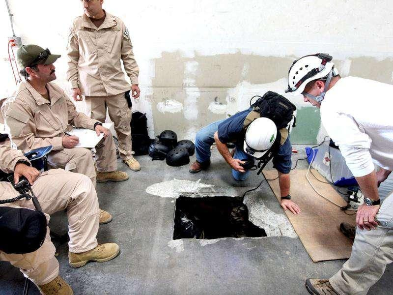 Agents prepare to enter a drug tunnel found in a warehouse in Otay Mesa, California. The tunnel, which led from the United States to a small business building in Tijuana, was the most sophisticated tunnel ever found in California and included an elevator, wood flooring an lighting. (AFP Photo)