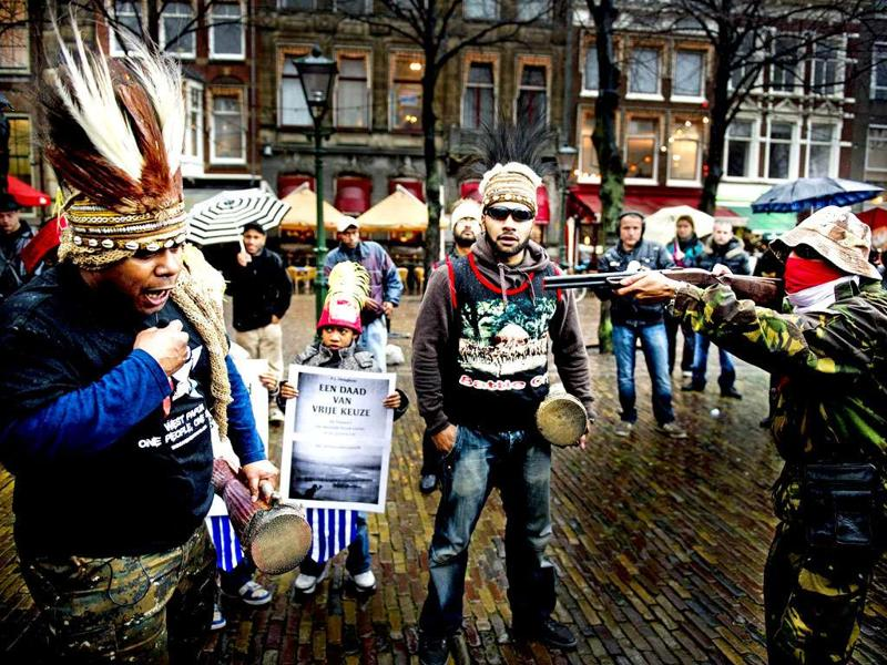 Protesters take part in a commemoration that marks the 50th anniversary of Papua's claim to independence in eastern Indonesia's restive region of Papua in The Hague. On December 1, 1961, Papuans first raised the Morning Star flag and sang a new national anthem after being granted freedom from more than 130 years of Dutch colonial rule.