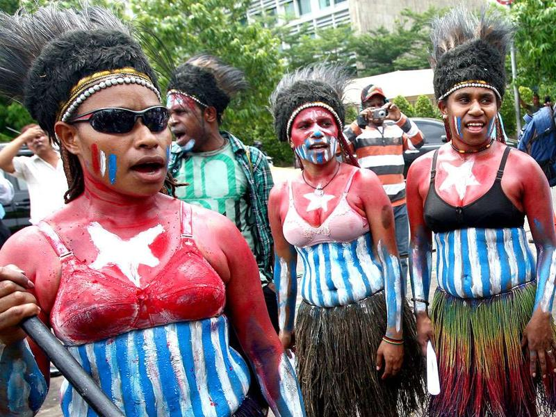 Papuan activists, their body painted with the colors of 'Morning Star' separatist flag, take part in a rally marking the 50th anniversary of failed efforts by Papuan tribal chiefs to declare independence from Dutch colonial rule in 1961, in Jakarta, Indonesia.