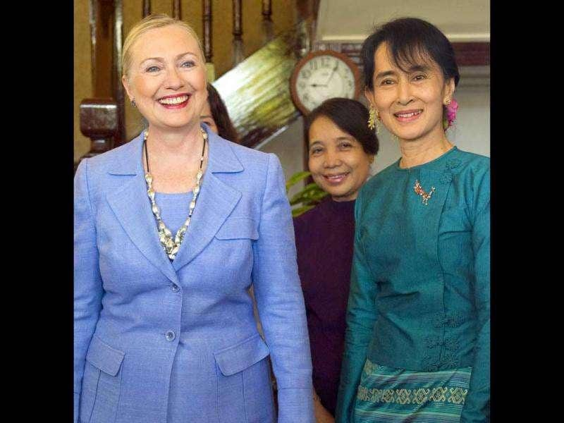 Myanmar's pro-democracy opposition leader Aung San Suu Kyi, right, and US secretary of state Hillary Rodham Clinton, left, at Suu Kyi's residence in Yangon, Myanmar. (AP Photo/Saul Loeb, Pool)