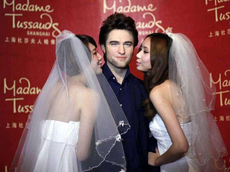 The waxwork of British actor Robert Pattinson is surrounded by 'brides' fans at Madame Tussauds in Shanghai, China.(AP/Eugene Hoshiko)