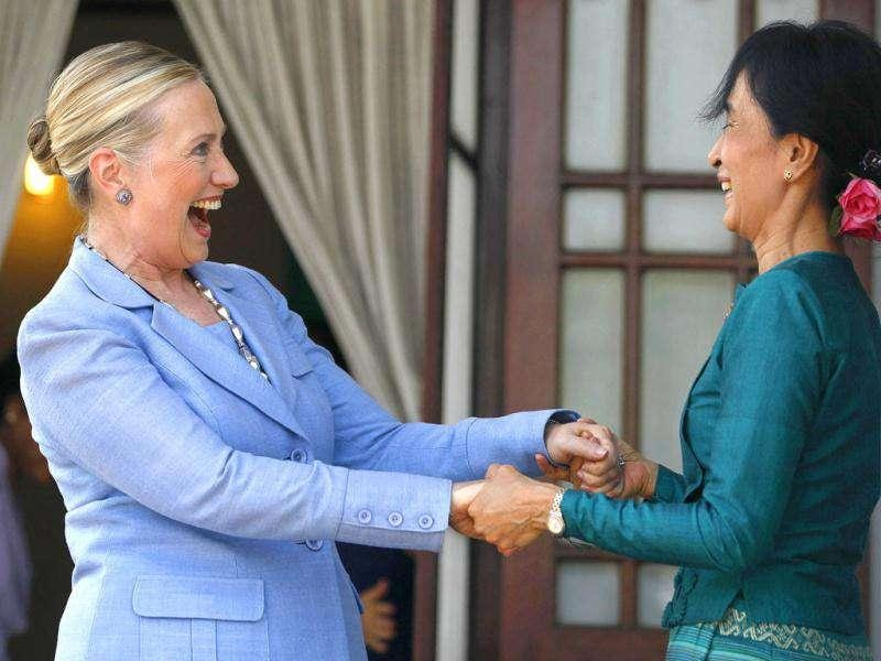 US secretary of state Hillary Clinton (L) holds hands with Myanmar's pro-democracy leader Aung San Suu Kyi as they meet at Suu Kyi's house in Yangon. (Reuters/Soe Zeya Tun)