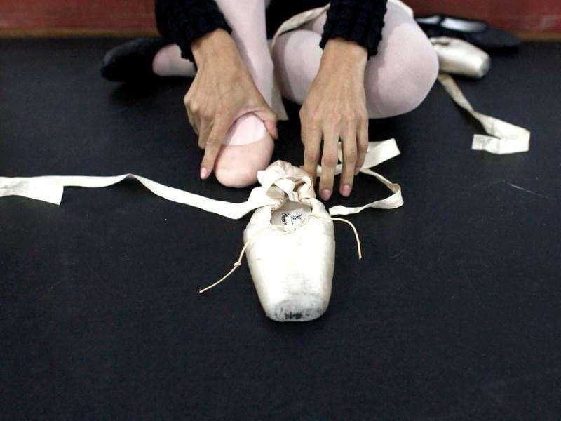 Blind ballet student Gayza Pereira puts on her slipper as she rehearses Don Quixote at the Association of Ballet and Arts for the Blind, in Sao Paulo. Reuters/Nacho Doce