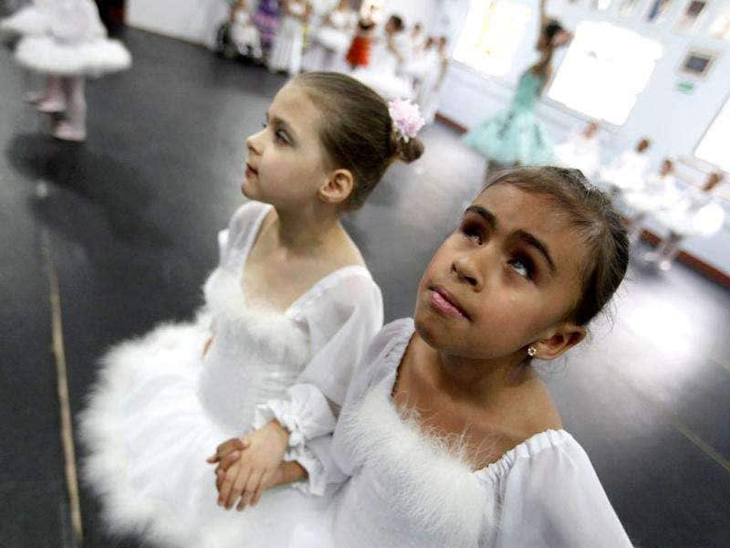 Deaf ballet student Raissa Goncalves and her blind classmate Vitoria Rodrigues rehearse Don Quixote at the Association of Ballet and Arts for the Blind, in Sao Paulo. Reuters/Nacho Doce