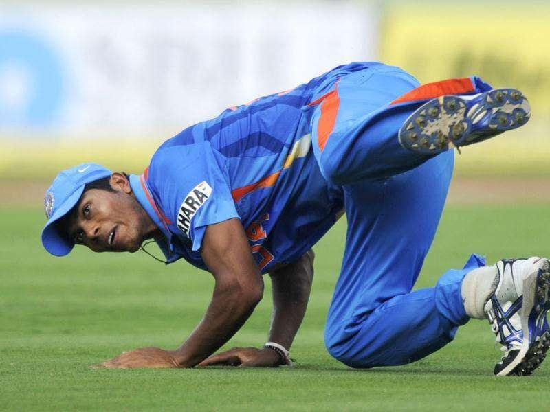 Indian cricketer Umesh Yadav dives to stop a ball during the second One Day International (ODI) match between India and the West Indies at The YS Rajasekhara Reddy Cricket Stadium in Visakhapatnam. (AFP Photo)