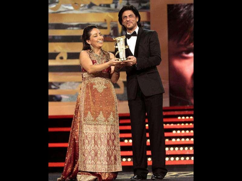 Shah Rukh Khan receives a tribute for his career from Moroccan actress Houda Rihani during the opening ceremony of the 11th Marrakech International Film Festival on December 2.