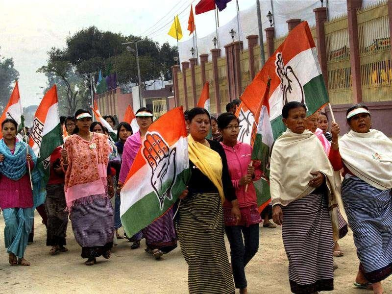 Congress workers arrive to welcome Prime Minister Manmohon Singh and UPA Chairperson Sonia Gandhi in Imphal. Prime Minister and Sonia Gandhi are on a day's visit to Manipur.