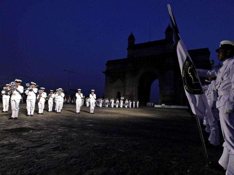 Naval band performs during a dress rehearsal ahead of Navy Day, in front of the landmark Gateway of India in Mumbai. Navy Day will be marked on Dec 4.